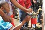 learners from Injoloba Secondary learn how to fix taps from professional plumbers